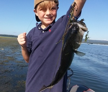 Fishing the weedbeds at Lake Guntersville with a weedless frog in fall can turn out some impressive bass, even for pint-sized anglers.
