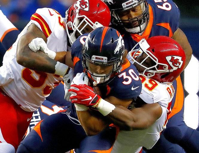 Kansas City Chiefs inside linebacker Reggie Ragland (59) tackles Denver Broncos running back Phillip Lindsay during an NFL game on Monday, Oct. 1, 2018, in Denver.