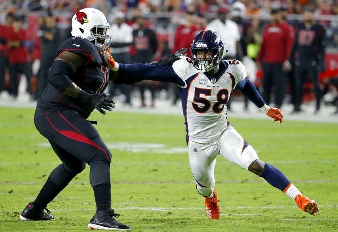 Arizona Cardinals offensive tackle Andre Smith (left) blocks against Denver Broncos outside linebacker Von Miller during an NFL game on Thursday, Oct. 18, 2018, in Glendale, Ariz.