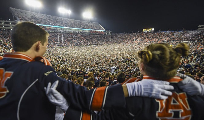 Auburn fans storm the field as they celebrate their 26-14 win over Alabama in the Iron Bowl Saturday, Nov. 25, 2017, at Jordan-Hare Stadium in Auburn, Ala.
