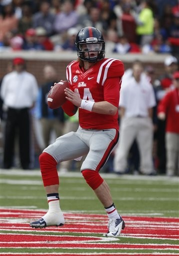 Ole Miss quarterback Bo Wallace looks for a receiver during an SEC game against Arkansas at Vaught-Hemingway Stadium in Oxford, Miss., on Saturday, Nov. 9, 2013. (AP Photo)