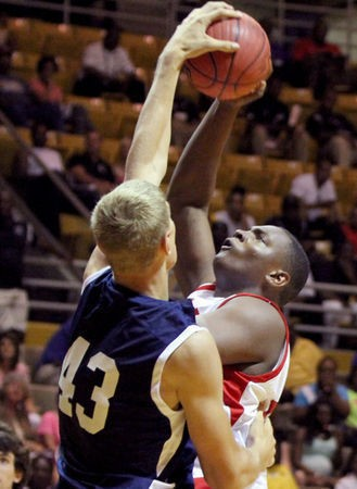 North's Isaac Haas blocks the shot of South's Brandon Murphy during Sports Week boys basketball in Montgomery, Ala., on July 17, 2013. (Dennis Victory/preps@al.com)