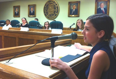 Pelham Youth Government Day council members Channing Knox, Ellie McPhearson, Maddie Goatley and Ena Imsirovic listen to student mayor Riley Coston during their meeting on Monday night, April 22, 2013, at Pelham City Hall. (Martin J. Reed / mreed@al.com)