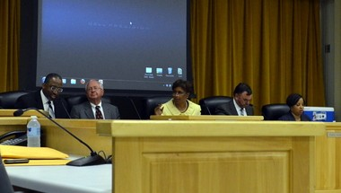 Birmingham City Schools Superintendent Craig Witherspoon, left, former state superintendent Ed Richardson, Birmingham Board of Education President April Williams, Vice President Brian Giattina and board member Carol Clarke are seen before the board's meeting Tuesday, June 11, 2013. (Jon Reed/jreed@al.com)