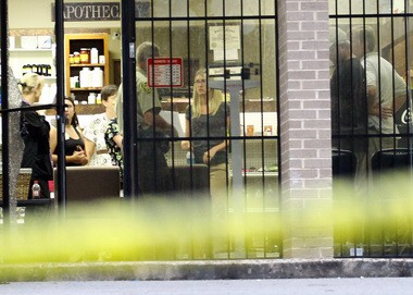 Employees of Plaza Apothecary speak to a Jefferson County sheriff's deputy after a robbery attempt on Aug. 6, 2013 in Graysville, Ala. (Paul Beaudry / pbeaudry@al.com)