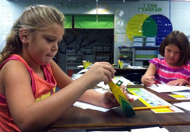 Meadow View Elementary second-graders Ashlee Reach and Maya Riendeau draw pictures on the first day of class on Monday, Aug. 19, 2013. (Martin J. Reed / mreed@al.com)