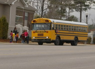 A Hoover school bus picks up students along Lorna Road in Hoover, Ala., in this file photo. (Steve Barnett/The Birmingham News)