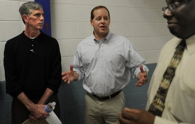 State Senator Cam Ward (center) speaks to media members during a tour as Kim Thomas, Commissioner of the Alabama Department of Corrections (left) and warden Carter Davenport listen at the St. Clair Correctional Facility Fri., March 16, 2012 in Springville, Ala. (The Birmingham News/Bernard Troncale)