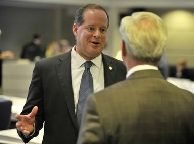 Sen. Cam Ward, left, R-Alabaster, talks to Sen. Greg Reed, R-Jasper, on the Senate floor Tuesday, Jan. 21, 2014, at the Statehouse in Montgomery, Ala. (Julie Bennett/jbennett@al.com)