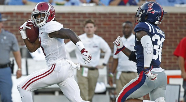 Alabama wide receiver Jerry Jeudy (4) runs past Mississippi defensive back Zedrick Woods (36) on his way to a 79-yard touchdown catch.