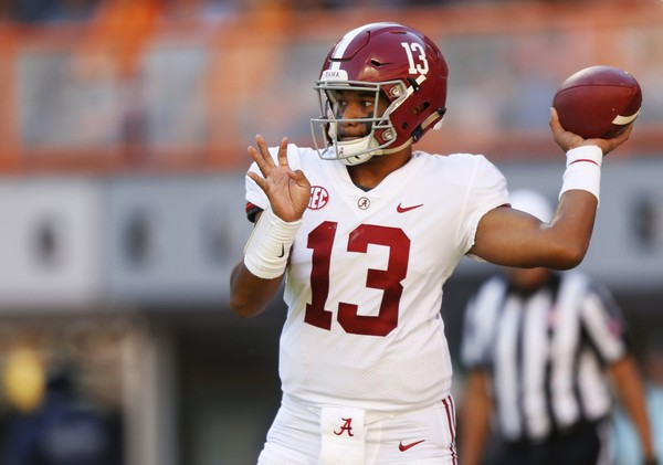 Alabama quarterback Tua Tagovailoa (13) throws to a receiver in the first half of an NCAA college football game against Tennessee Saturday, Oct. 20, 2018, in Knoxville, Tenn. (AP Photo/Wade Payne) AP