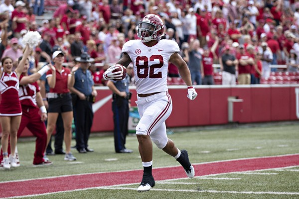 Alabama tight end Irv Smith Jr. scores on the first play of the game Saturday at Arkansas.