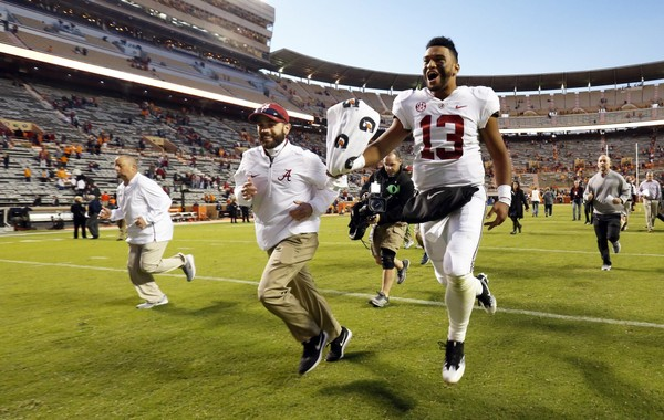 Alabama quarterback Tua Tagovailoa (13) celebrates as he leaves the field after an NCAA college football game against Tennessee Saturday, Oct. 20, 2018, in Knoxville, Tenn. Alabama won 58-21. (AP Photo/Wade Payne) AP