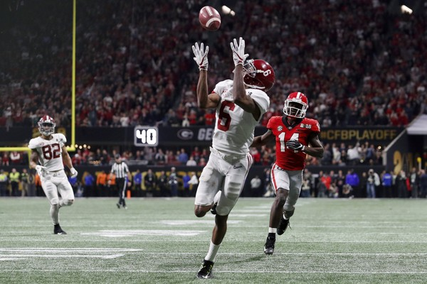 Alabama wide receiver DeVonta Smith (6) scores the game winning touchdown in overtime during the College Football Playoff National Championship game between Georgia and Alabama.