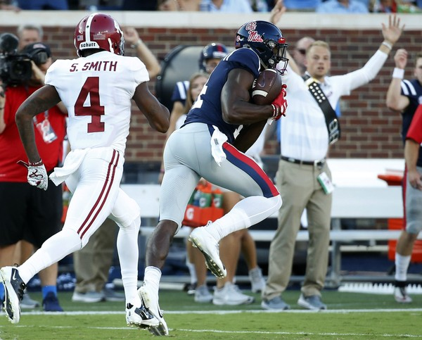 Mississippi wide receiver D.K. Metcalf (14) hauls in a 75-yard touchdown pass while Alabama defensive back Saivion Smith (4) pursues on the first play. It was the Rebels' only score.