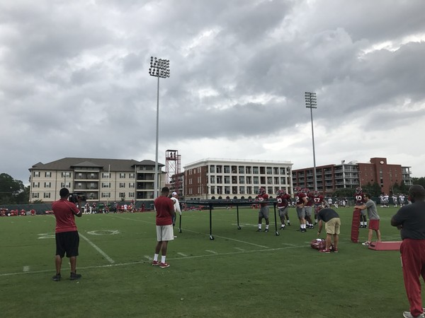 Residental buildings with Alabama practice field views include Central Park (left), Champions Place (middle) and The Chimes (right).