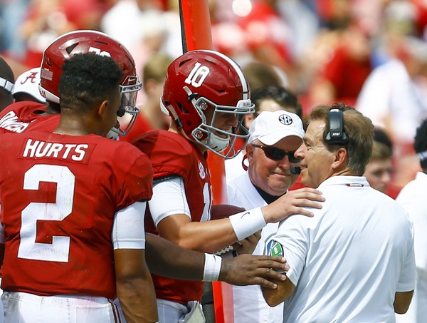 Alabama quarterback Mac Jones (10) talks with Alabama head coach Nick Saban after throwing a touchdown pass during the second half of an NCAA college football game against Louisiana-Lafayette, Saturday, Sept. 29, 2018, in Tuscaloosa, Ala. Alabama won 56-14. (AP Photo/Butch Dill) AP