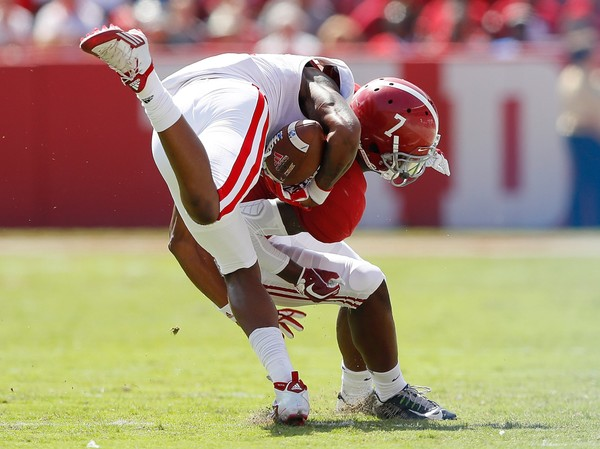 Trevon Diggs (7) of the Alabama Crimson Tide forces a fumble against the Louisiana Ragin' Cajuns at Bryant-Denny Stadium on Sept. 29 in Tuscaloosa.