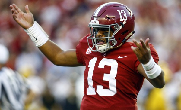 6a8422075c0 Alabama quarterback Tua Tagovailoa (13) gestures after throwing a touchdown pass  during the first