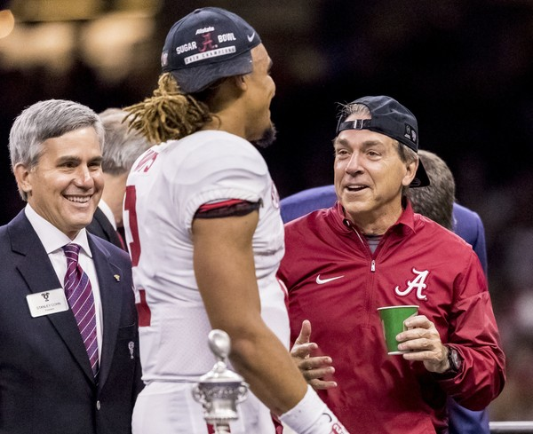 Alabama head coach Nick Saban tries a new look with his hat on backward as he and Alabama quarterback Jalen Hurts (2) celebrate on stage after winning the Alabama vs Clemson CFP semifinal Sugar Bowl, Monday, Jan. 1, 2018, at the Mercedes-Benz Superdome in New Orleans. Vasha Hunt/vhunt@al.com ORG XMIT: ALBIN401 AP