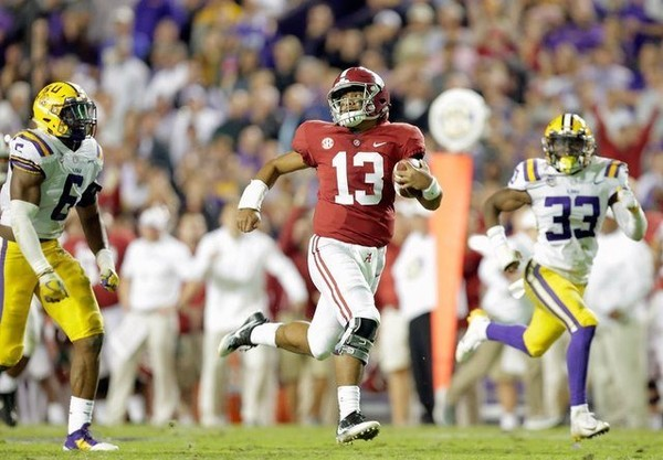 Alabama Crimson Tide quarterback Tua Tagovailoa (13) runs for a touchdown during second half action against the LSU Tigers in Baton Rouge on Saturday. (Brett Duke, NOLA.com | The Times-Picayune)
