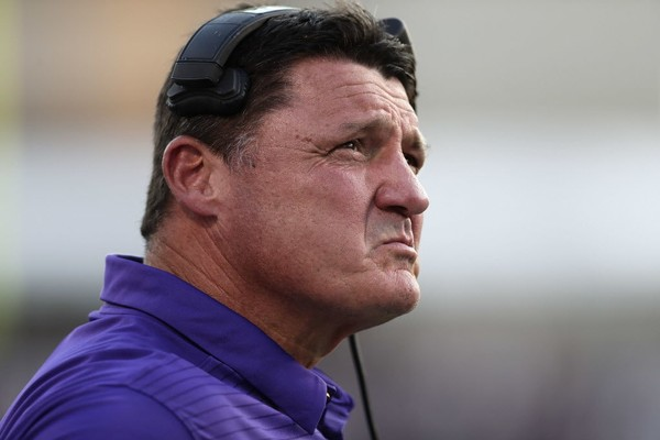 LSU head coach Ed Orgeron looks at a replay in the Tigers game with Mississippi State.