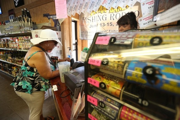 Sheryle Maudsley of Gadsden, Ala. plays the Florida Lottery at the Flora-Bama Liquor and Lottery in Perdido Key, Fla. on Wednesday, July 27, 2016. Many who were playing want to see the lottery in Alabama. (Brian Kelly/bkelly@al.com)