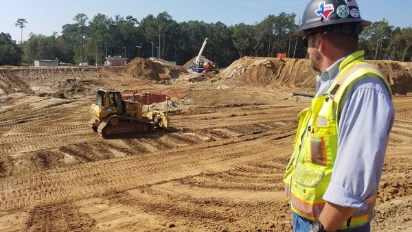 Construction Superintendent Kevin Callahan, of J & P Construction, looks over the site of a Severe Weather Attenuation Basin his company is building for the Mobile Area Water & Sewer System. When completed, it will protect Halls Mill Creek from sewer overflows. (Lawrence Specker/LSpecker@AL.com)