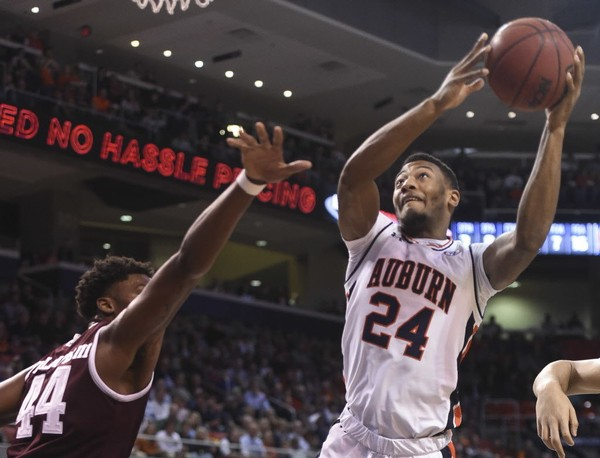 Auburn forward Anfernee McLemore (24) shoots over Texas A&M forward Robert Williams (44) Wednesday, Feb. 7, 2018, during the first half at Auburn Arena in Auburn, Ala.
