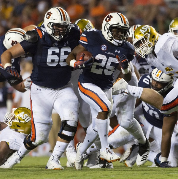 Auburn running back Shaun Shivers (25) runs up the middle during the second half against Alabama State Sept. 8 in Auburn.