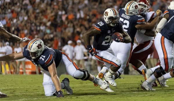 Auburn running back JaTarvious Whitlow (28) runs during the first half against Arkansas in Auburn Sept. 22.