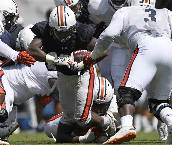JaTarvious Whitlow is tackled by Derrick Brown during Auburn's second fall scrimmage on Wednesday.