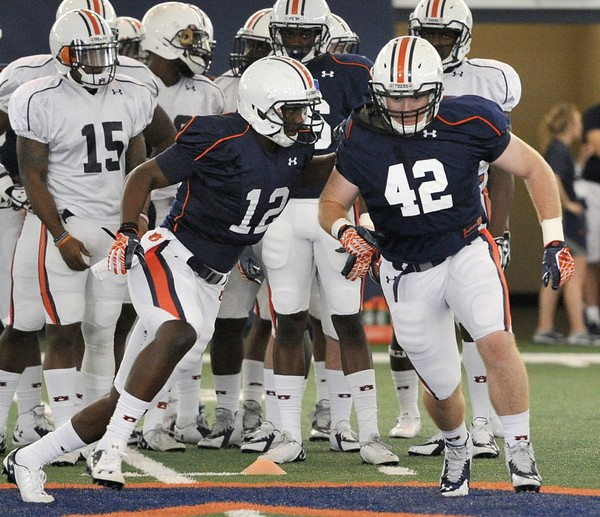 Auburn wide receiver Jonathan Wallace works out with fullback Keenan Sweeney Tuesday, March 17, 2015, during spring football practice at the Auburn Athletic Complex in Auburn, Ala.