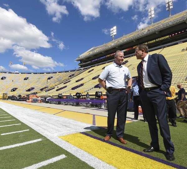 Auburn athletic director Jay Jacobs talks with head coach Gus Malzahn before the LSU game Saturday, Oct. 14, 2017, at Tiger Stadium in Baton Rouge, La. (Julie Bennett/jbennett@al.com)