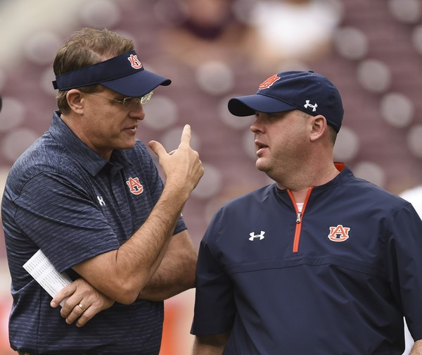 Auburn head coach Gus Malzahn talks with offensive coordinator Chip Lindsey before the game against Texas A&M Saturday, Nov. 4, 2017, at Kyle Field in College Station, Texas.