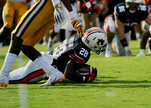 Auburn running back Boobee Whitlow is tripped up during last weekend's loss to LSU. Auburn players hope to flush the loss and not let it bleed over into this week's game against Arkansas. (Madison Ogletree/AL.com)