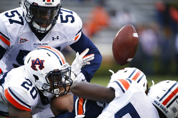 Auburn running back Cedric Chambers, bottom right, fumbles the ball during the first half of a spring NCAA college football game, Saturday, April 7, 2018, in Auburn, Ala.