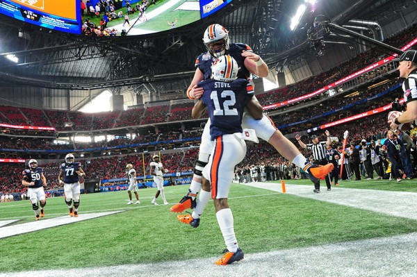 Auburn tight end Tucker Brown celebrates a touchdown by Eli Stove during the Peach Bowl, (Scott Cunningham/Getty Images)