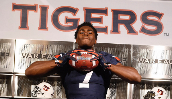 Three-star defensive end Colby Wooden committed to Auburn over Clemson.