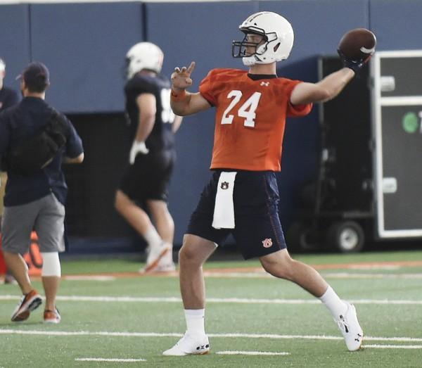 Quarterback Cord Sandberg throws during Auburn's practice on Sunday.