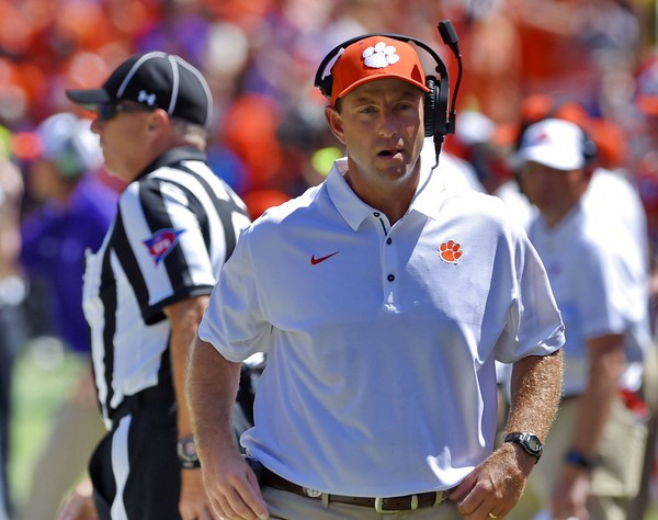 Clemson head coach Dabo Swinney walks the sidelines during the first half of an NCAA college football game against Kent State Saturday, Sept. 2, 2017, in Clemson, S.C. Clemson won 56-3.
