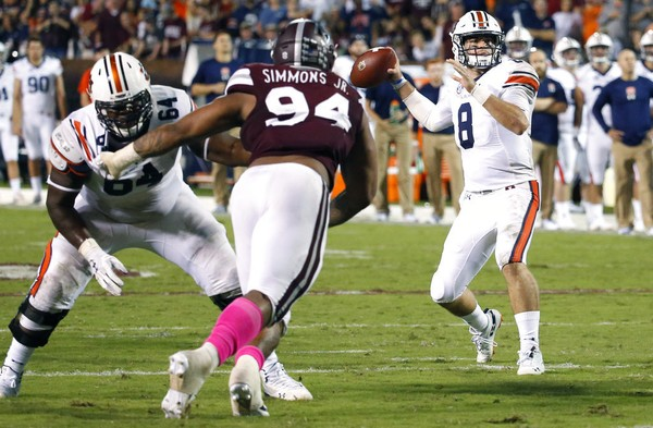 Auburn quarterback Jarrett Stidham looks downfield in the second half against Mississippi State. Despite the loss, Auburn feels it built some momentum offensively heading into this week's game against Tennessee. (AP Photo/Rogelio V. Solis)