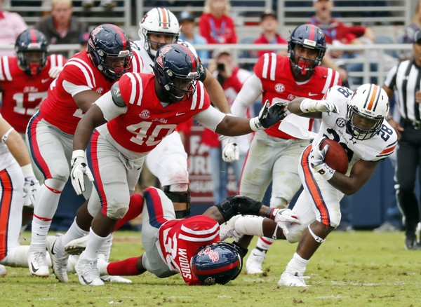Auburn running back Boobee Whitlow runs against Ole Miss on Saturday. Whitlow had a career-best 170 yards on the ground against the Rebels. (AP Photo/Rogelio V. Solis)