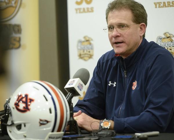 Auburn head coach Gus Malzahn talks to the press Wednesday, Dec. 27, 2017, during a Peach Bowl press conference in Atlanta, Ga.