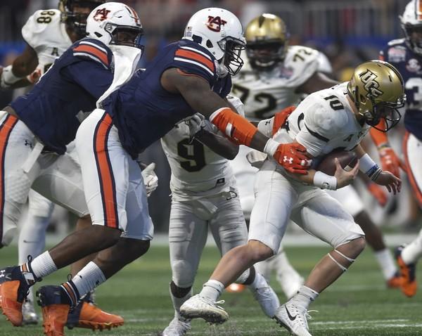 Auburn linebacker Jeff Holland (4) sacks UCF quarterback McKenzie Milton (10) Monday, Jan. 1, 2017, during the second half of the Peach Bowl at Mercedes Benz Stadium in Atlanta, Ga. (Julie Bennett/jbennett@al.com)