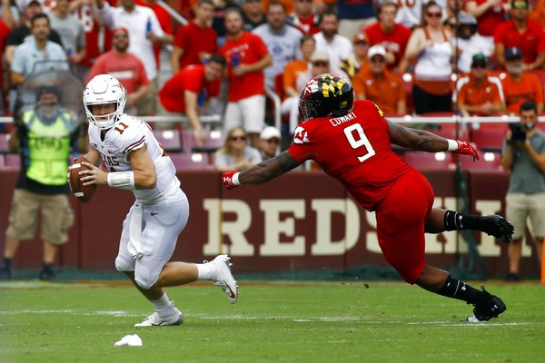 Texas quarterback Sam Ehlinger, left, looks for a receiver as he is pressured by Maryland defensive lineman Byron Cowart in the first half of an NCAA college football game, Saturday, Sept. 1, 2018, in Landover, Md.
