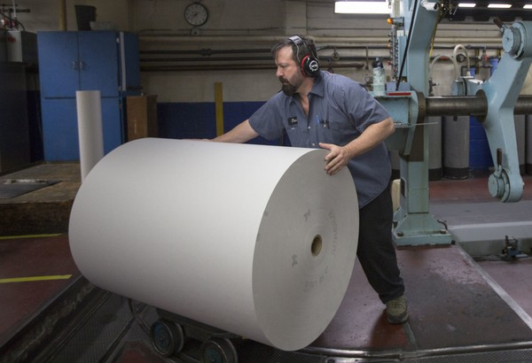 VANCOUVER, WA - APRIL 18: Jason Campbell adjusts rolls of newsprint before printing at The Columbian newspaper on April 18, 2018 in Vancouver, Washington. In January of 2017 the the U.S. Commerce Department imposed tariffs as much as 32 percent on Canadian newsprint causing paper prices to wildly skyrocket. The new prices may harm newspapers, already operating on razor thin margins, across the United States. (Photo by Natalie Behring/Getty Images)