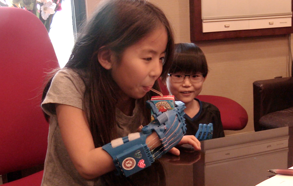 A group of Alabama students are providing children with prosthetic devices mad with 3-D printers.