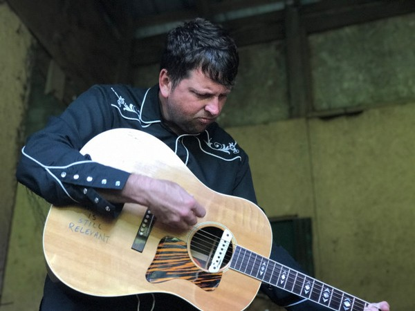 Abe Partidge, 37, is a former pastor whose journey led him to a career as a singer-songwriter in in his hometown of Mobile.
