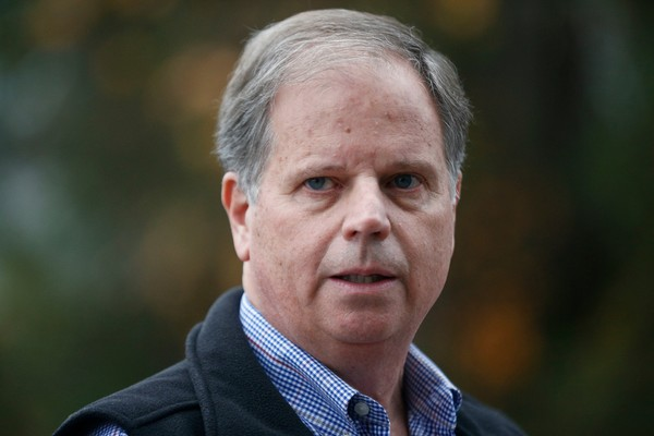 "FILE - In this Dec. 4, 2017 file photo, Democratic senatorial candidate Doug Jones speaks at a news conference in Dolomite, Ala. Jones, the Alabama Democrat who unexpectedly prevailed in one of the country's most Republican states, has a book coming out next year. St. Martin's Press told The Associated Press on Tuesday that Jones' ""Bending Toward Justice: The Birmingham Church Bombing that Changed the Course of Civil Rights"" is scheduled for January. (AP Photo/Brynn Anderson, File)"